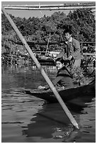 Couple leaving market on their boat. Inle Lake, Myanmar ( black and white)