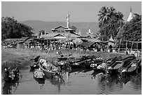 Villagers arriving by boat at market. Inle Lake, Myanmar ( black and white)