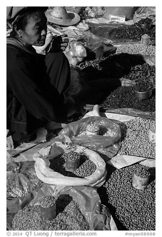Market vendor with cheerot cigar. Inle Lake, Myanmar (black and white)