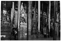 Old wood sculptures inside Nga Phe Kyaung monastery. Inle Lake, Myanmar ( black and white)