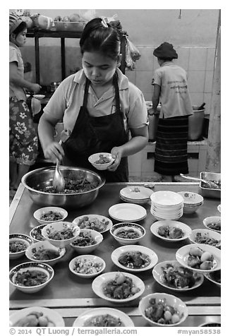 Cooks serving Burmese food. Bago, Myanmar (black and white)