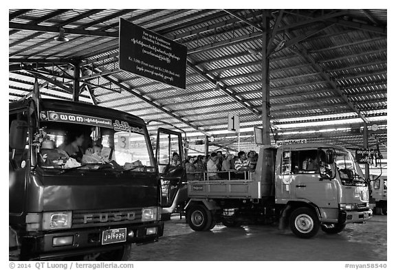 Busses and sign at base station. Kyaiktiyo, Myanmar (black and white)