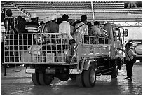 Bus leaving base station with 35 passengers in the back. Kyaiktiyo, Myanmar ( black and white)