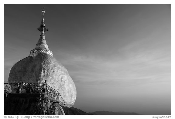 Golden Rock and monk, late afternoon. Kyaiktiyo, Myanmar (black and white)