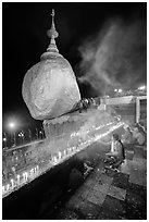 Offerings to the Buddha continues throughout the night at the Golden Rock. Kyaiktiyo, Myanmar ( black and white)