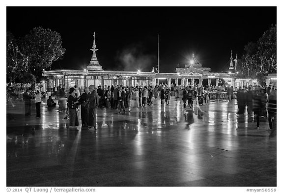 Crowds on main plaza at night. Kyaiktiyo, Myanmar (black and white)