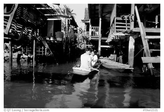 Houses along khlong on Thonbury canals. Bangkok, Thailand (black and white)