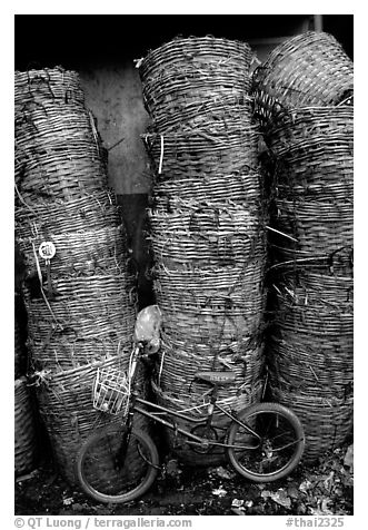 Bicycle and baskets near market. Bangkok, Thailand (black and white)