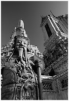 Statue and tower, Wat Arun. Bangkok, Thailand (black and white)