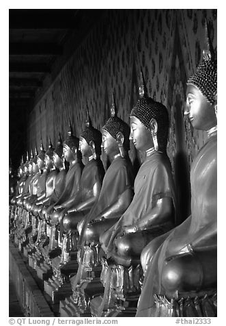 Row of Buddha statues in gallery, Wat Arun. Bangkok, Thailand (black and white)
