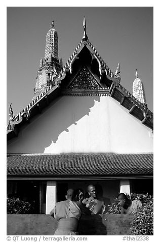 Monks outside Wat Arun. Bangkok, Thailand (black and white)