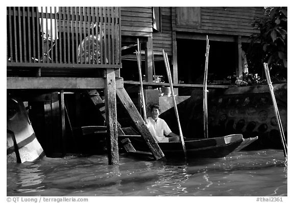 Conversation with neighbor along Thonbury canal. Bangkok, Thailand (black and white)