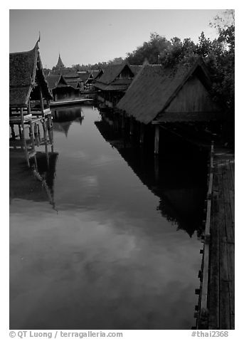 Village along canal. Muang Boran, Thailand (black and white)