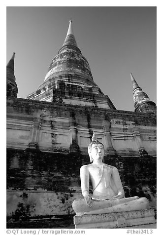 Buddha statue and Wat Chai Mongkon. Ayuthaya, Thailand (black and white)