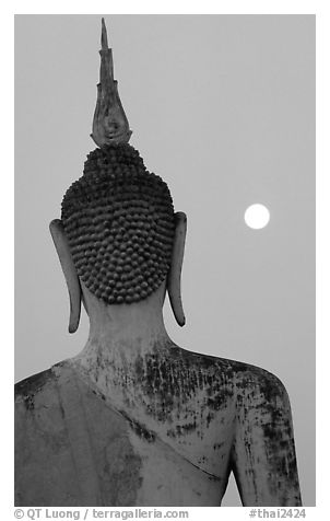 Moon and buddha image at dusk, Wat Mahathat. Sukothai, Thailand