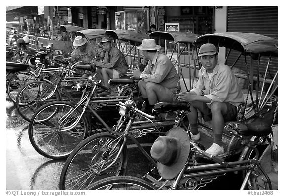 Tricycle drivers. Chiang Rai, Thailand (black and white)