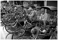 Tricycle drivers. Chiang Rai, Thailand ( black and white)