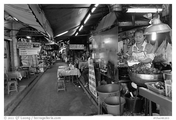 Food stall in alley. Bangkok, Thailand (black and white)