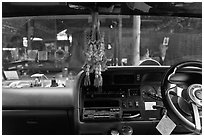 Bus dashboard with religious items. Thailand (black and white)