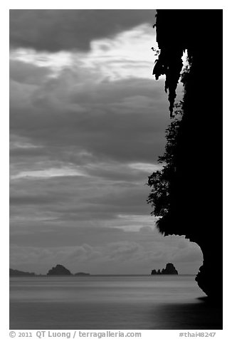 Seascape with limestone islets, stalactite, dusk, Andamam Sea. Krabi Province, Thailand (black and white)
