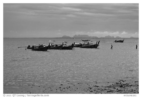 Boats anchored at low tide, storm sky,  Railay East. Krabi Province, Thailand (black and white)