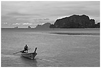 Man driving long tail boat, Ao Nammao. Krabi Province, Thailand (black and white)