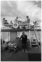 Local woman and tourists on boat, Adaman Sea. Krabi Province, Thailand (black and white)