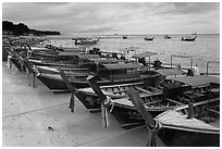 Longtail boats lined up, Ao Ton Sai, Ko Phi Phi. Krabi Province, Thailand ( black and white)
