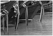Prows of longtail boats with garlands, Ko Phi-Phi Don. Krabi Province, Thailand ( black and white)