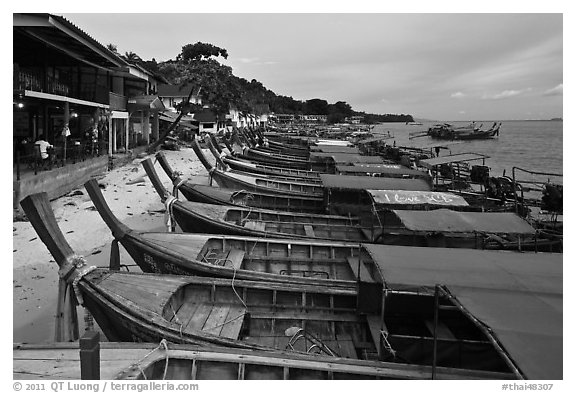 Boats and waterfront houses at dusk Ao Ton Sai, Ko Phi-Phi Don. Krabi Province, Thailand (black and white)