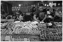 Restaurant with seefood on skewers, Phi-Phi island. Krabi Province, Thailand ( black and white)