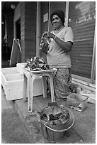 Woman selling grilled seafood, Tonsai village, Ko Phi-Phi island. Krabi Province, Thailand ( black and white)