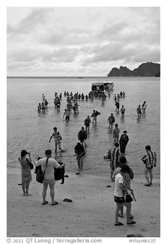 Large group of tourists disembarking from boats, Ko Phi-Phi Don. Krabi Province, Thailand (black and white)
