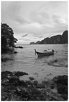 Boat in cove, Ko Phi-Phi island. Krabi Province, Thailand ( black and white)