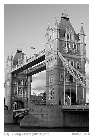 Close view of the two towers of the Tower Bridge. London, England, United Kingdom (black and white)