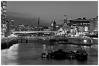 HMS Belfast, London Bridge, and Thames at night. London, England, United Kingdom (black and white)
