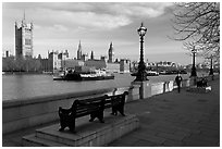 Riverfront promenade, Thames River, and Westminster Palace. London, England, United Kingdom (black and white)