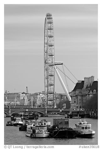 Boats, Thames River, and London Eye. London, England, United Kingdom (black and white)