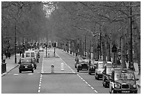 Black cabs and street near Saint James Park with. London, England, United Kingdom ( black and white)