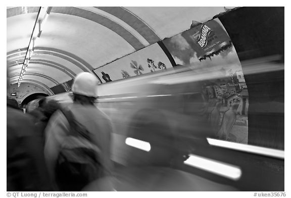 People and train in motion, London underground. London, England, United Kingdom (black and white)