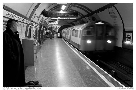Man waiting for approaching train at Hyde Park subway station. London, England, United Kingdom