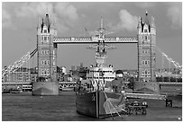 HMS Belfast cruiser and Tower Bridge, late afternoon. London, England, United Kingdom ( black and white)