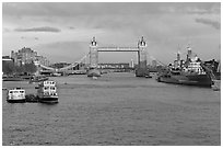 Thames River, Tower Bridge, HMS Belfast, late afternoon. London, England, United Kingdom (black and white)