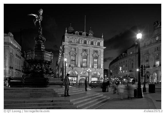 Piccadilly Circus and Eros statue at night. London, England, United Kingdom (black and white)