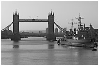 London Bridge, River Thames, and cruiser HMS Belfast at sunrise. London, England, United Kingdom (black and white)