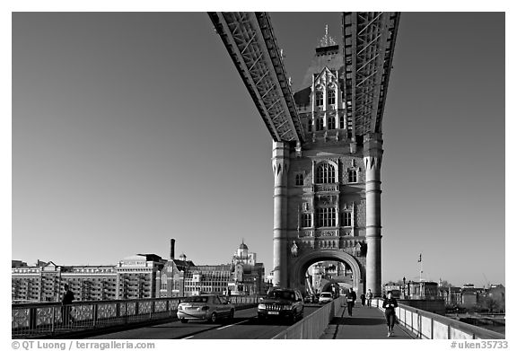 Jogger and South Tower of Tower Bridge,  early morning. London, England, United Kingdom (black and white)