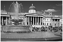 Fountain ( designed by Lutyens in 1939) and National Gallery, Trafalgar Square. London, England, United Kingdom (black and white)