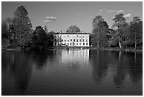 Museum No 1 reflected in lake, late afternoon. Kew Royal Botanical Gardens,  London, England, United Kingdom (black and white)