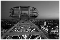 Millenium Wheel capsule and Houses of Parliament at dusk. London, England, United Kingdom ( black and white)