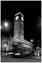 Big Ben and double decker bus in motion at nite. London, England, United Kingdom (black and white)